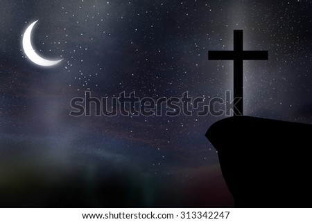 Silhouette of Cross against at Night sky abstract background - stock photo