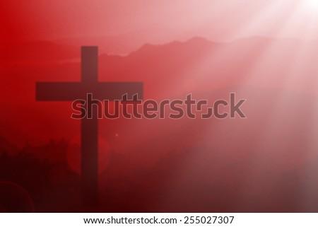 Silhouette of cross on mountain. - stock photo