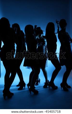 Silhouette of dancing women - stock photo