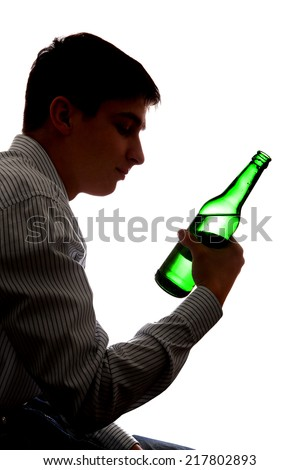 Silhouette of Depressed Young Man in Alcohol addiction on the White Background - stock photo