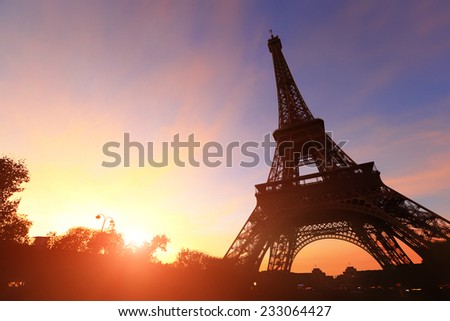 silhouette of eiffel tower in Paris with sunset - stock photo
