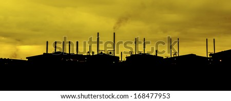Silhouette of factories - stock photo