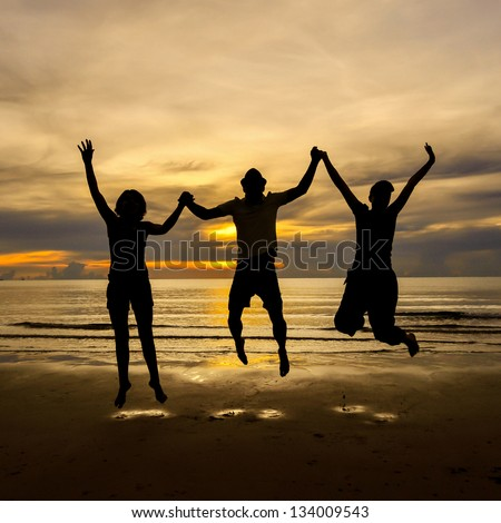 Silhouette of family jumping on the beach , Hua Hin ,Thailand - stock photo
