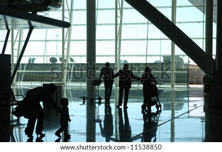 silhouette of family waiting at the airport - stock photo