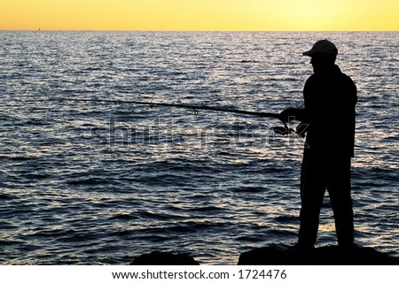 Silhouette of Fisherman at sunset - Cottesloe beach , Perth - stock photo