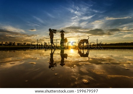silhouette of fishermen - stock photo