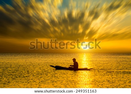 silhouette of fishermen in a boat. - stock photo