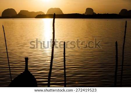 Silhouette of  Fishing village and sunrise at Samchong-tai, Phangnga, Thailand - stock photo