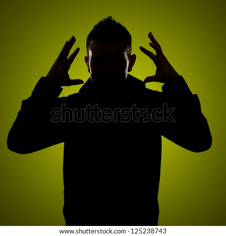 Silhouette Of Frustrated Man Isolated On Green Background - stock photo