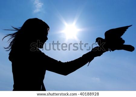Silhouette of girl and bird. Conceptual design. - stock photo