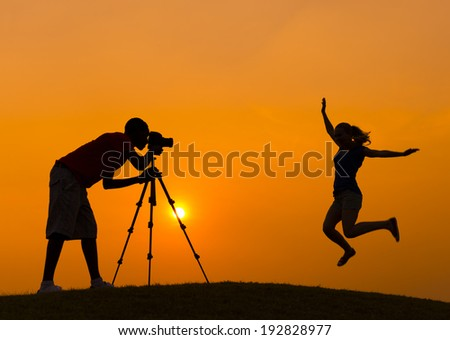 Silhouette of Girl And Photographer - stock photo