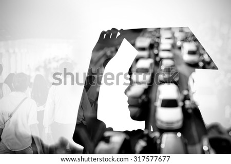 Silhouette of graduate woman with traffic jam background , black and white - stock photo