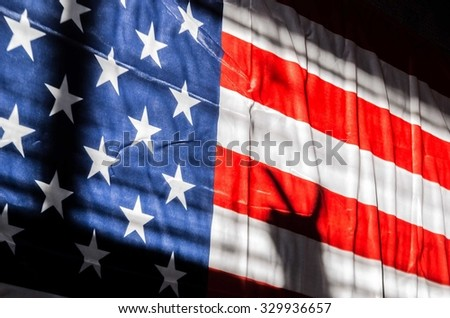 Silhouette of hand with two fingers in victory concept with flag of USA background Empty space for inscription or other objects No face Unrecognizable person - stock photo