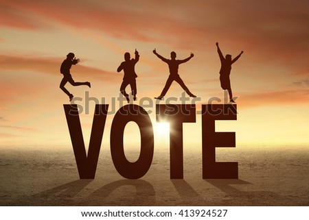 Silhouette of happy people jumping over a VOTE word at sunset time - stock photo