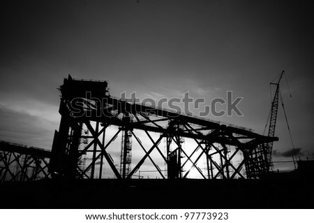 silhouette of jacket leg under construction in high contrast black and white - stock photo