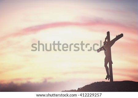 Silhouette of Jesus with Cross over sunset concept for religion, worship, Christmas, Easter, Redeemer Thanksgiving prayer and praise - stock photo