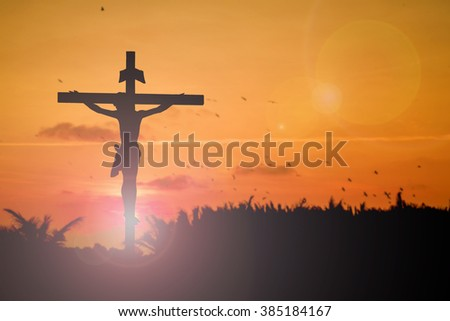 Silhouette of Jesus with Cross over sunset concept for religion, worship, prayer and praise. - stock photo