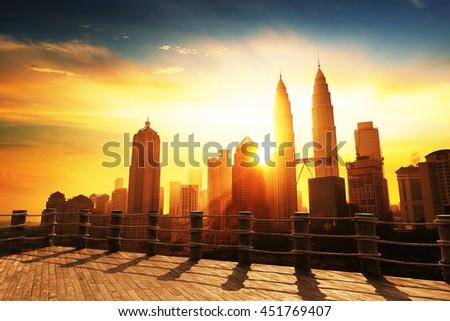 Silhouette of Kuala Lumpur skyline during sunrise at Malaysia, Asia  - stock photo