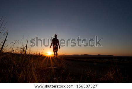 silhouette of man enjoying sunset over freiburg  - stock photo