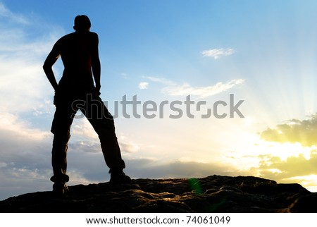Silhouette of man in mountain. Conceptual scene. - stock photo