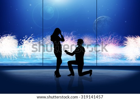 silhouette of man makes a proposal a silhouette woman in space room  - stock photo