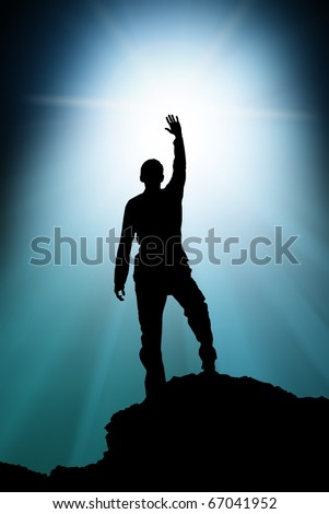Silhouette of man touch the sun. - stock photo