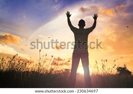 Silhouette of man with hands raised to beautiful golden autumn sunset background. World Mental Health Day, Worship, Christmas, Thanksgiving, Forgiveness, Mercy, Humble, Repentance, Reconcile concept. - stock photo
