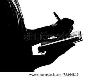Silhouette of man writing business diary. Isolated on white - stock photo