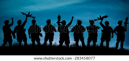 Silhouette of military soldiers team or officer with weapons at night. shot, holding gun, blue colorful sky, background - stock photo