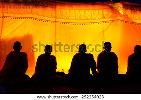 Silhouette of Monk liturgy or pray for funeral at funeral ceremony in Thailand - stock photo