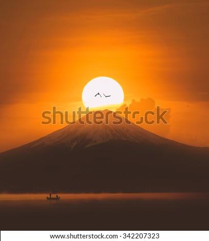 Silhouette of Mount Fuji at Lake kawaguchiko , Sunrise ,vintage - stock photo