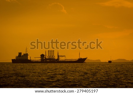 Silhouette of Oil exploration vessel - stock photo