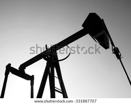 Silhouette of oil pump. Pump rocking. Crude oil production - stock photo