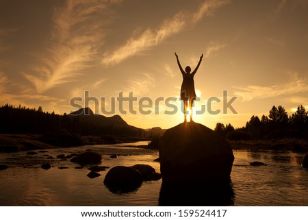 Silhouette of Outdoor Yoga, Young Woman in Sun Salutation - stock photo