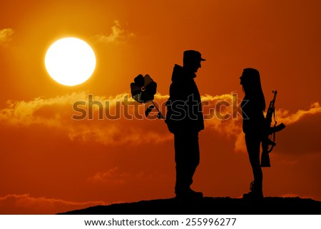 Silhouette of peace and love versus war and anger. No war, soldier and girl, weapon and flower toy, peace in world, sunset, landscape - stock photo