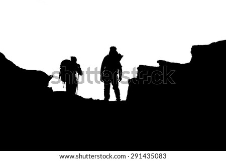 silhouette of people hiking up a mountain, isolated against a white background  - stock photo