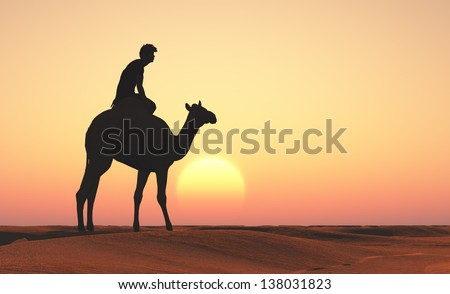 Silhouette of people on camel. - stock photo