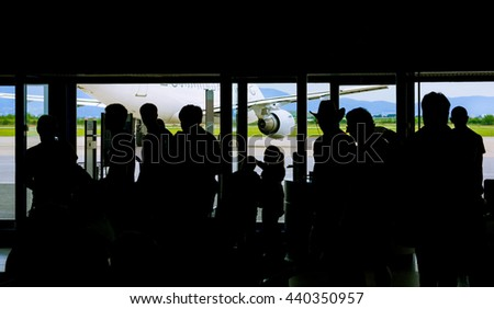 Silhouette of people waiting on airport - stock photo