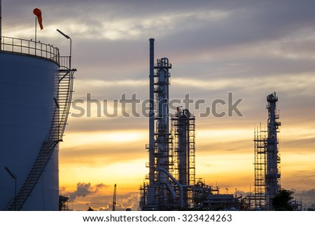 Silhouette of petrochemical industry at twilight sky - stock photo