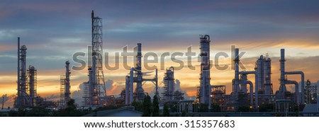 Silhouette of petrochemical plant or Oil and gas refinery in sunrise - stock photo
