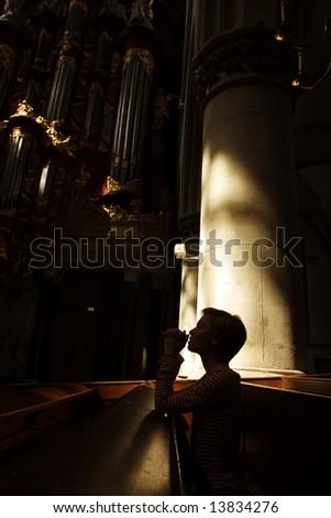 silhouette of praying woman. - stock photo