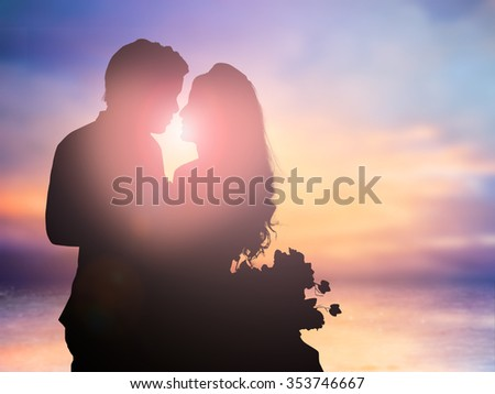 silhouette of romantic lovers couple over blurred natural backgrounds:love concept.valentines concept - stock photo