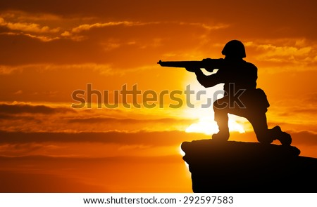 Silhouette of soldier on the edge. Element of design. - stock photo
