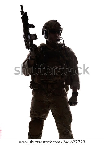 Silhouette of special warfare operator with assault rifle - stock photo