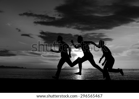 Silhouette of stack photo one man moving his body on the beach at dusk. - stock photo