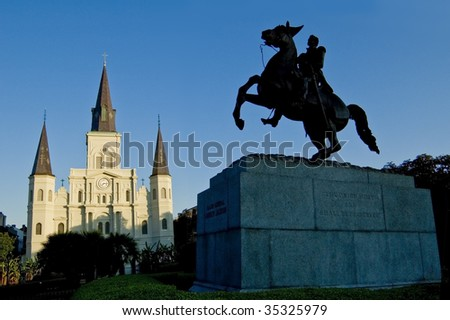 Silhouette of statue in Jackson Square, New Orleans, with St. Louis Cathedral in background - stock photo