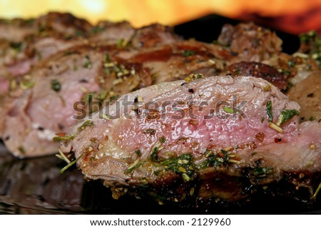 Silhouette of summer garden BBQ roast isolated against fire background - stock photo