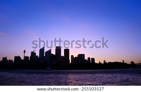 Silhouette of Sydney skyline at dusk - stock photo