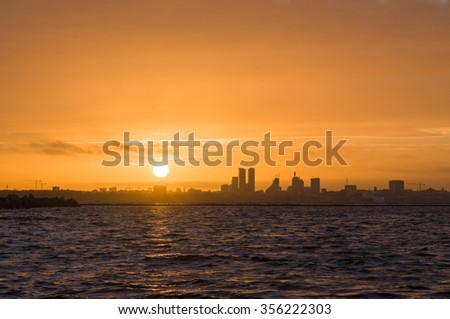 Silhouette of Tallinn city before sunset, Estonia - stock photo