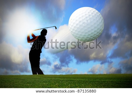 Silhouette of the golfer with flying ball - stock photo